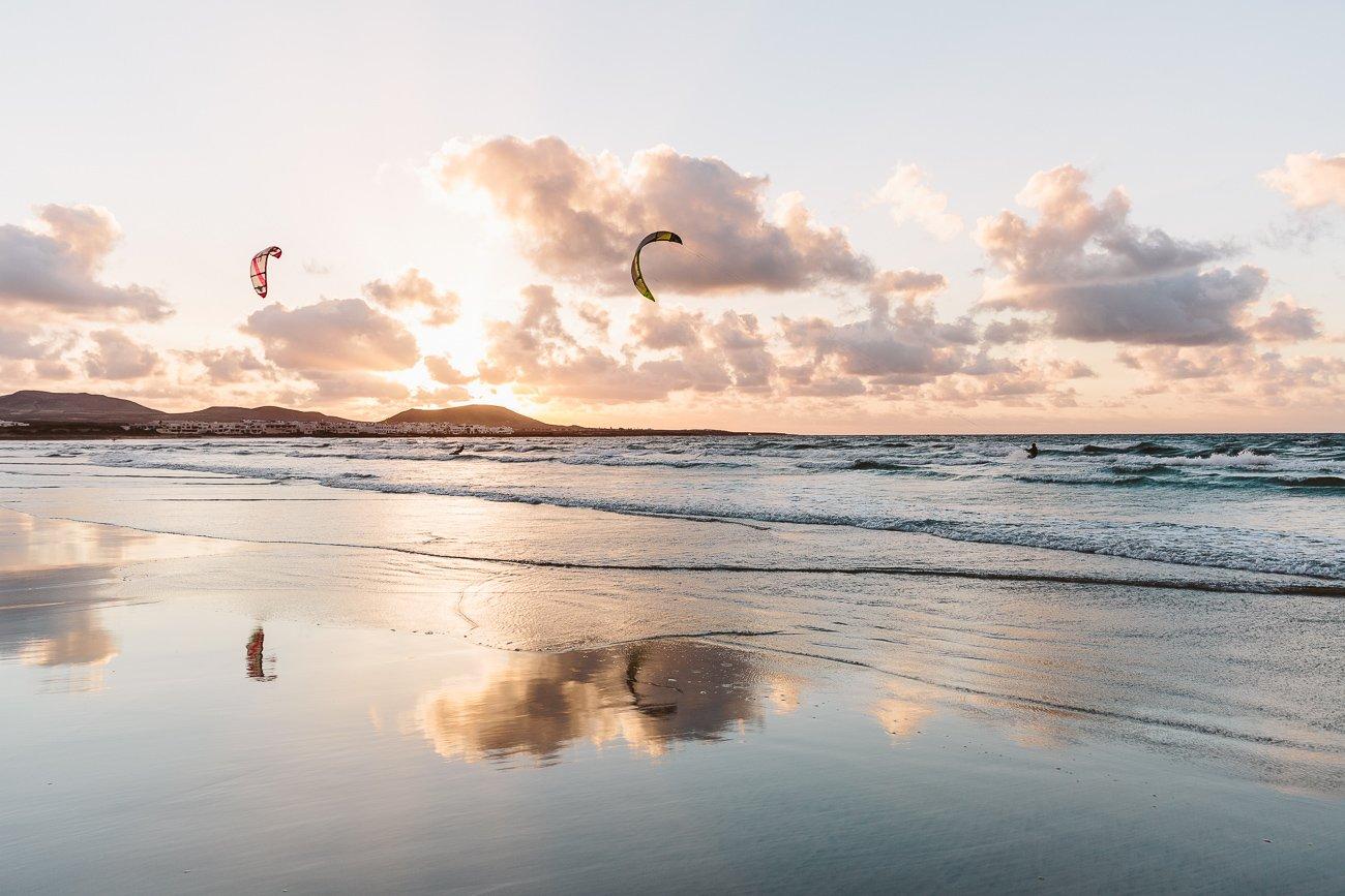 Sunset and Kite Surfers at Famara beach Lanzarote