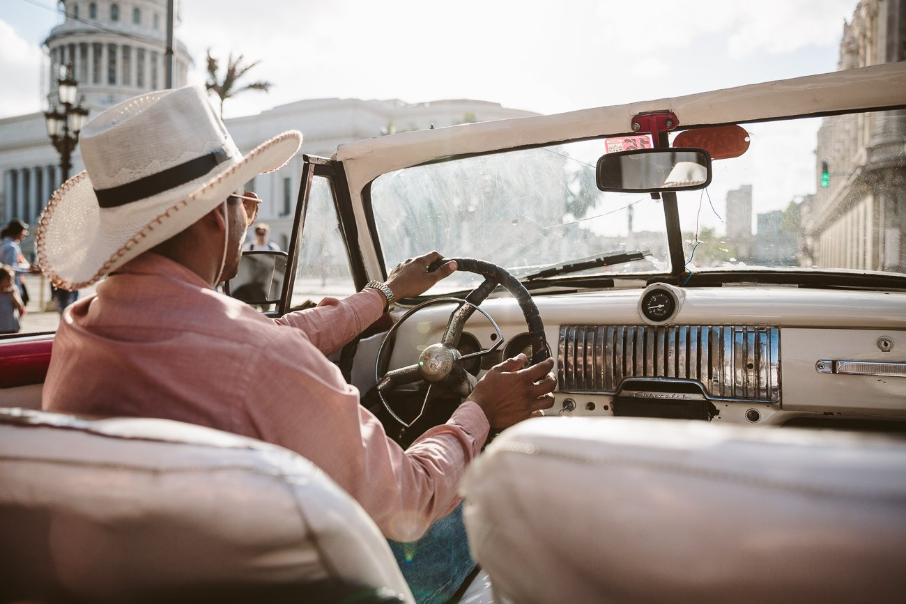 Riding a vintage car in Havana