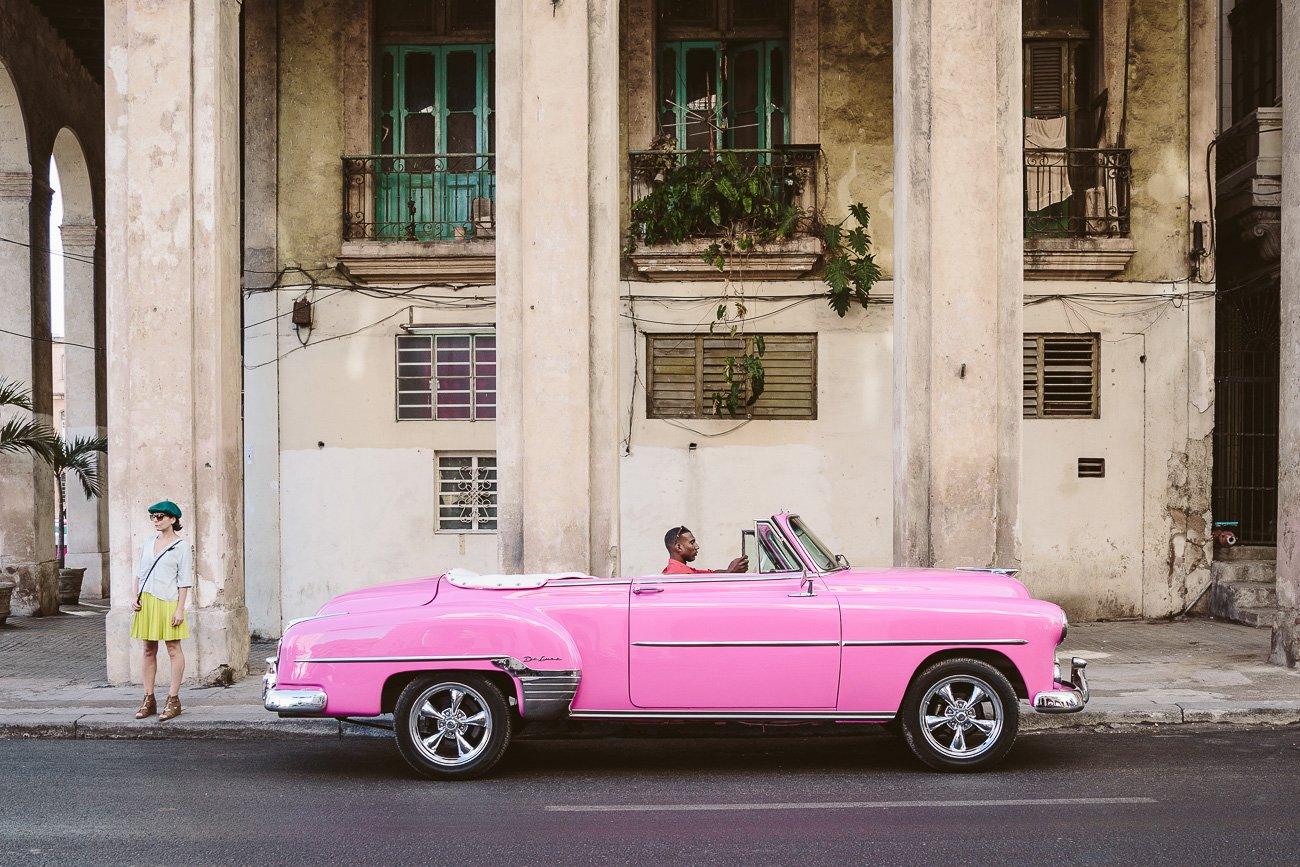 A pink vintage car parks in Havana Cuba