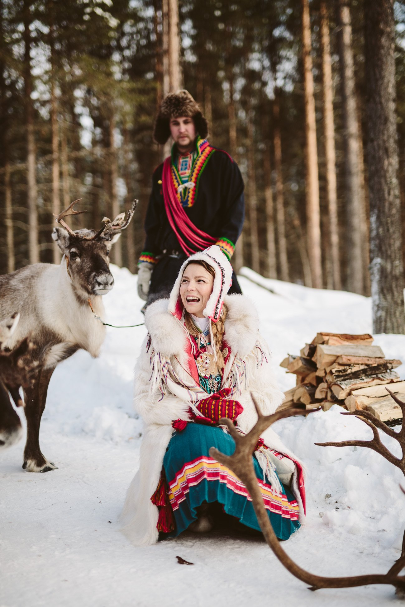 Sami girl Anne Kuhmunen and her reindeer in Swedish Lapland