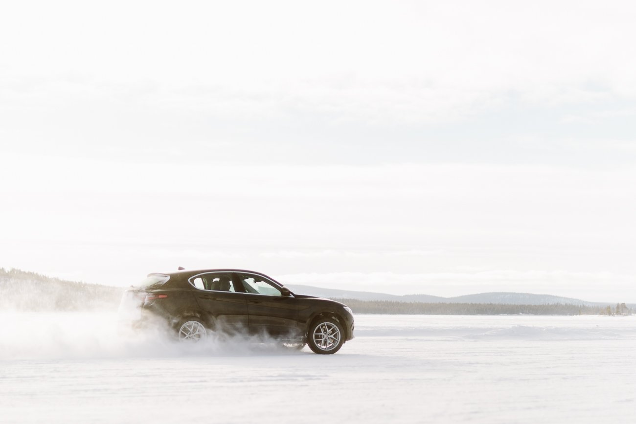 Riding over a frozen lake with an Alfa Romeo Stelvio in Swedish Lapland