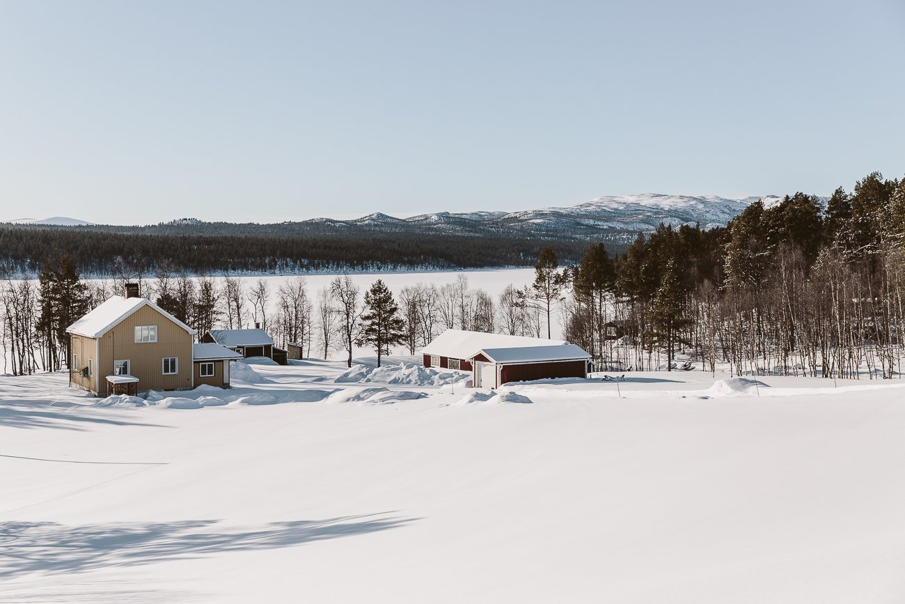 Swedish Lapland frozen lake and wooden houses