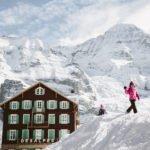 Kids playing in the snow at Kleine Scheidegg Jungfrau Switzerland