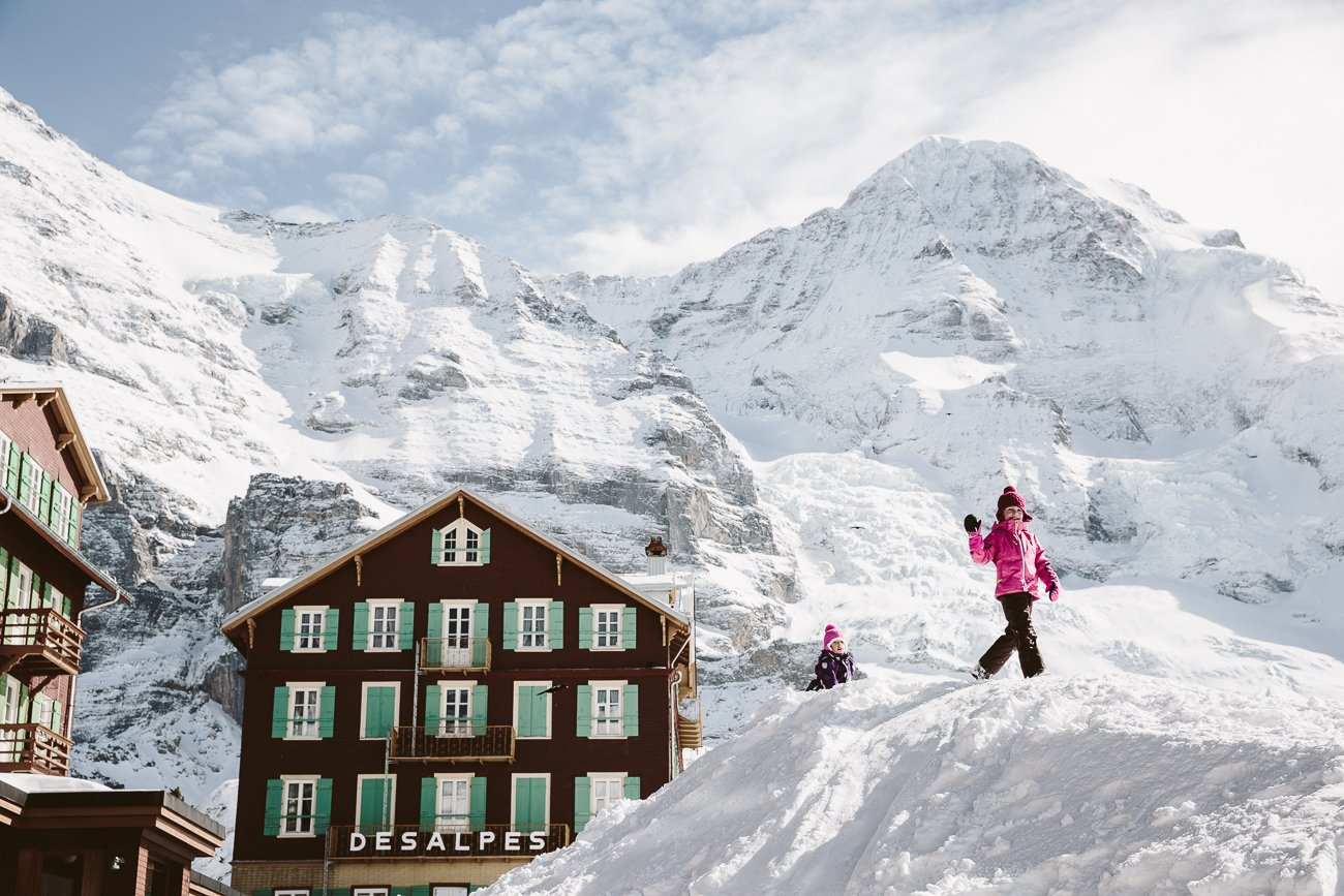 Kids playing in the snow at Kleine Scheidegg Jungfrau Switzerland