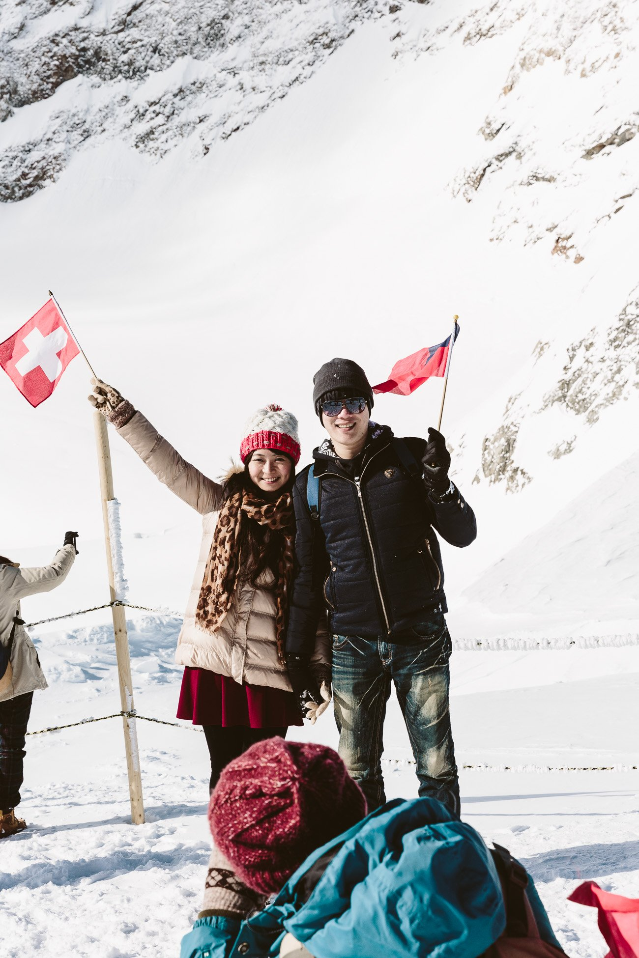 Asian tourists in the snow at Jungfraujoch