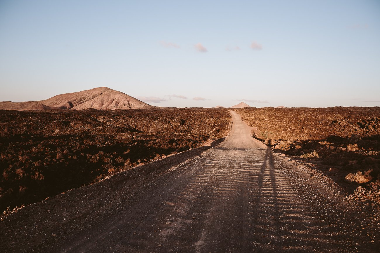 Road through Timanfaya National Park at the coastline of Lanzarote