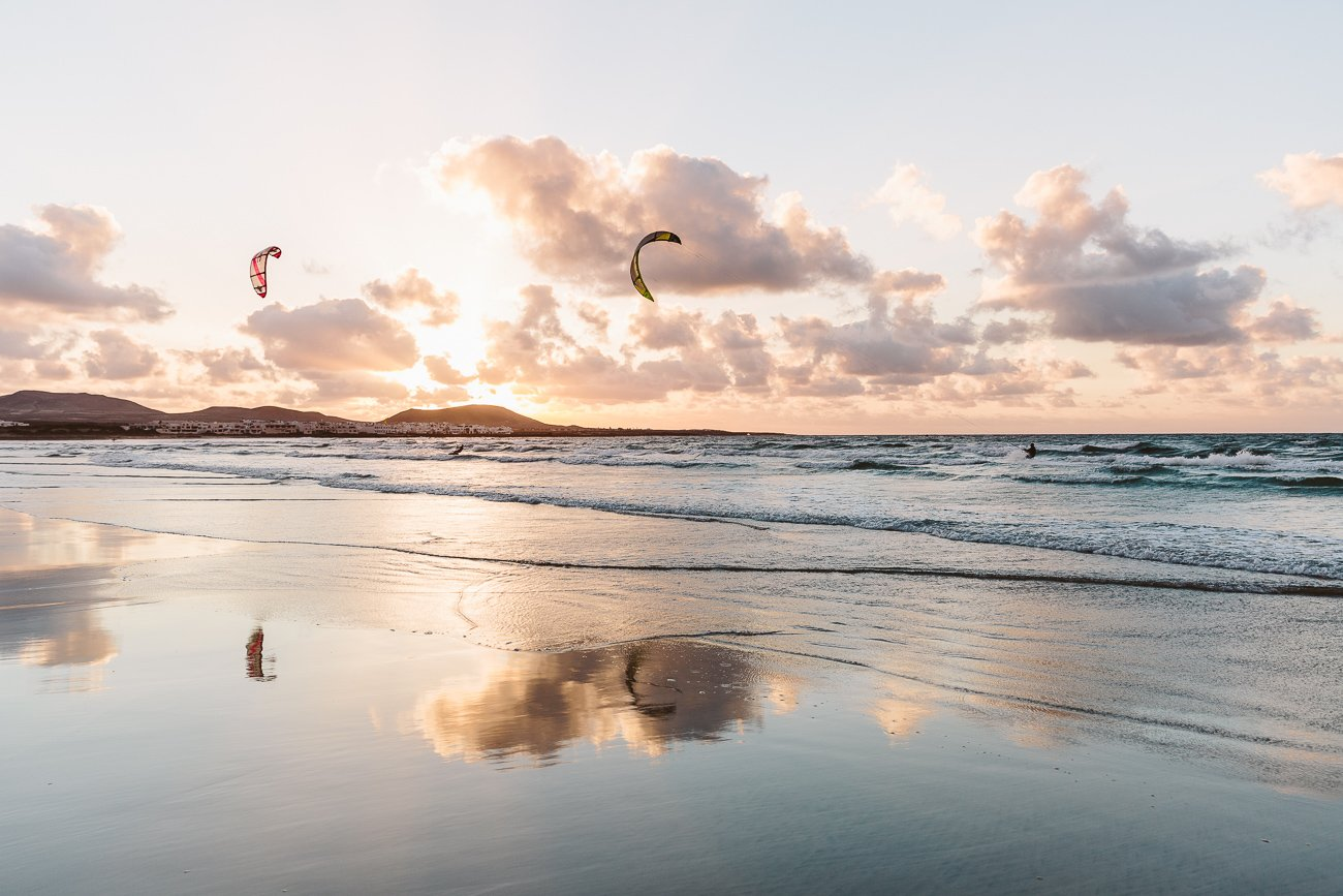 Sunset and Kite Surfers at Famara beach Lanzarote