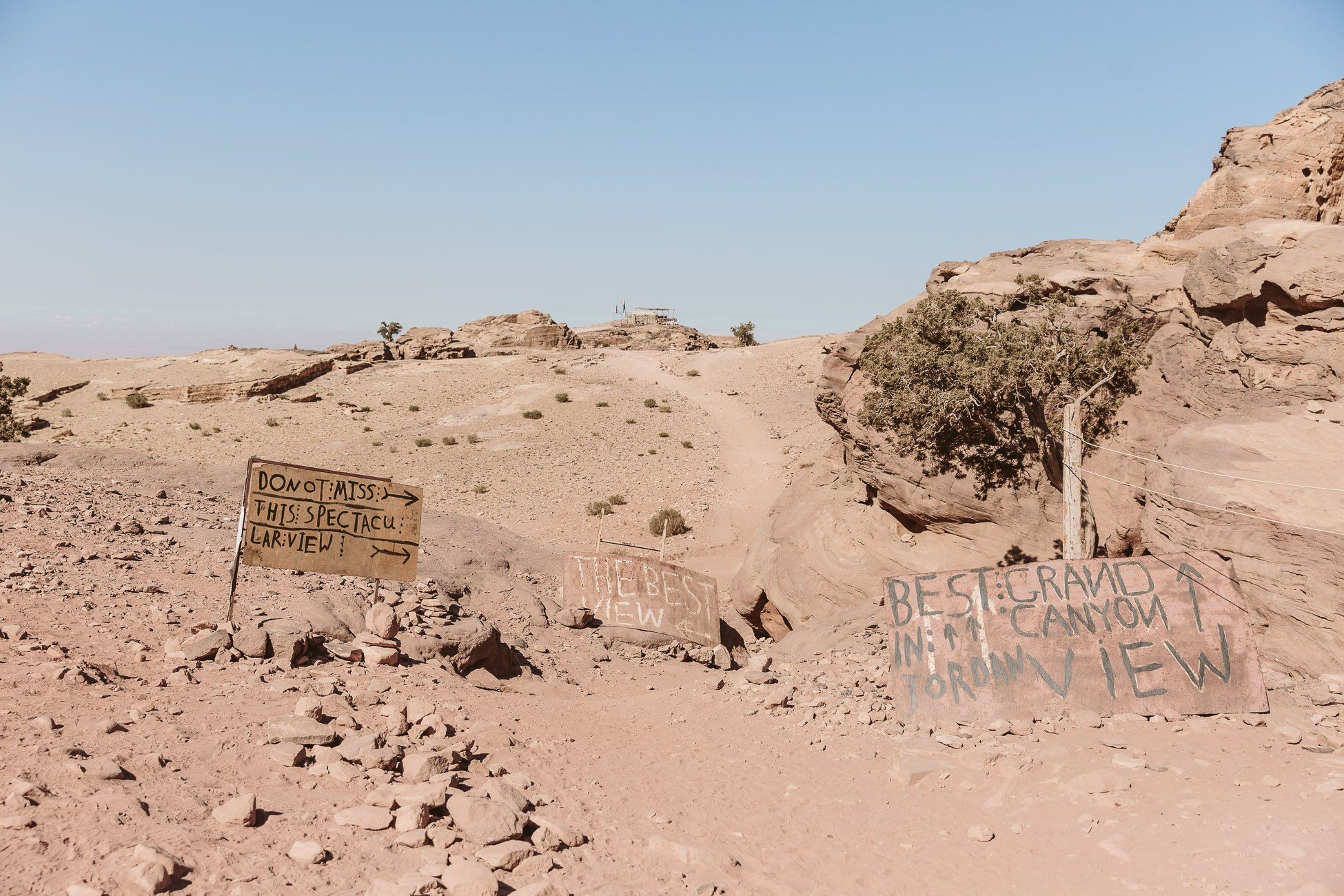 Signs pointing to the Best View in Petra Jordan