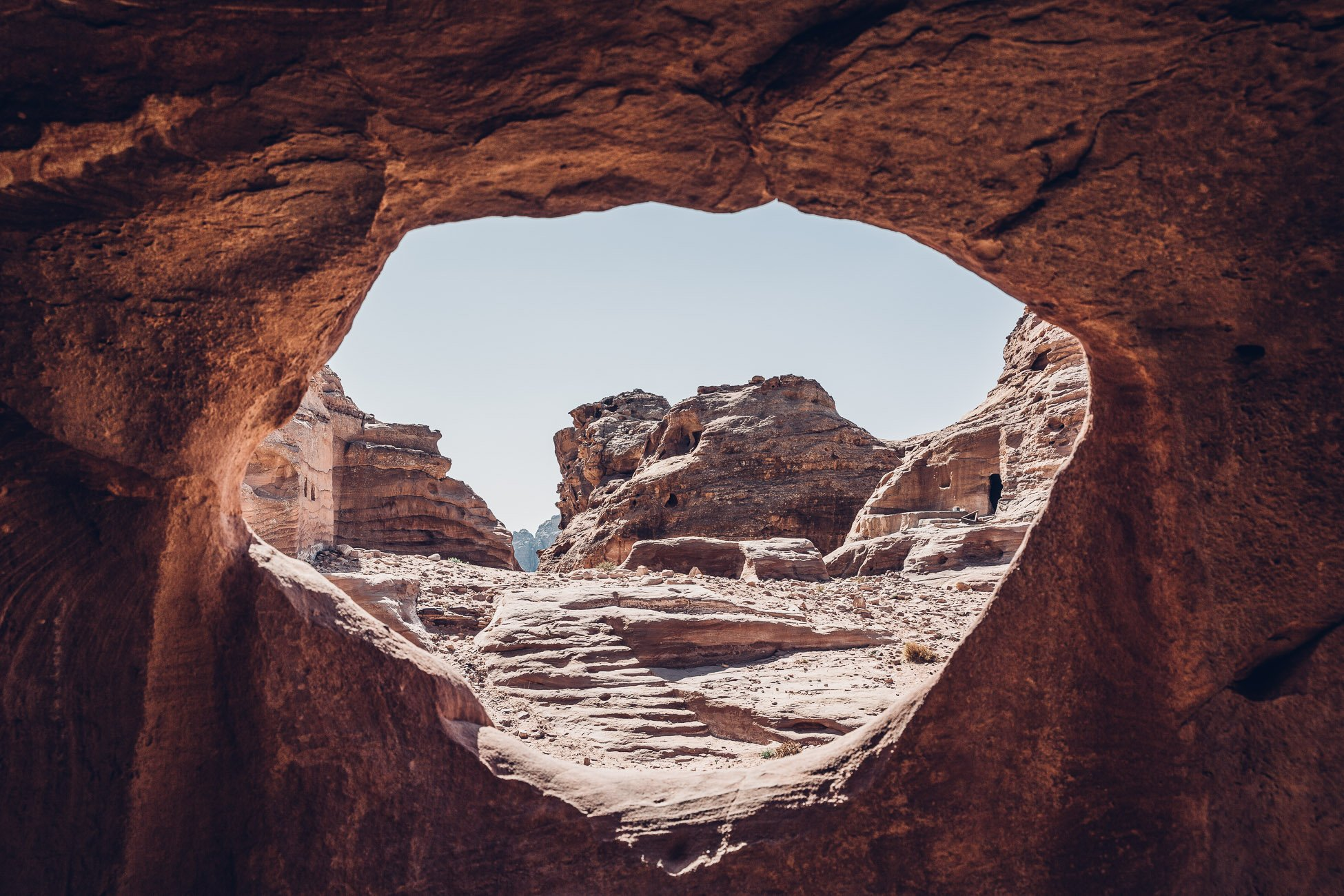 View of Petra through a hole in a cave