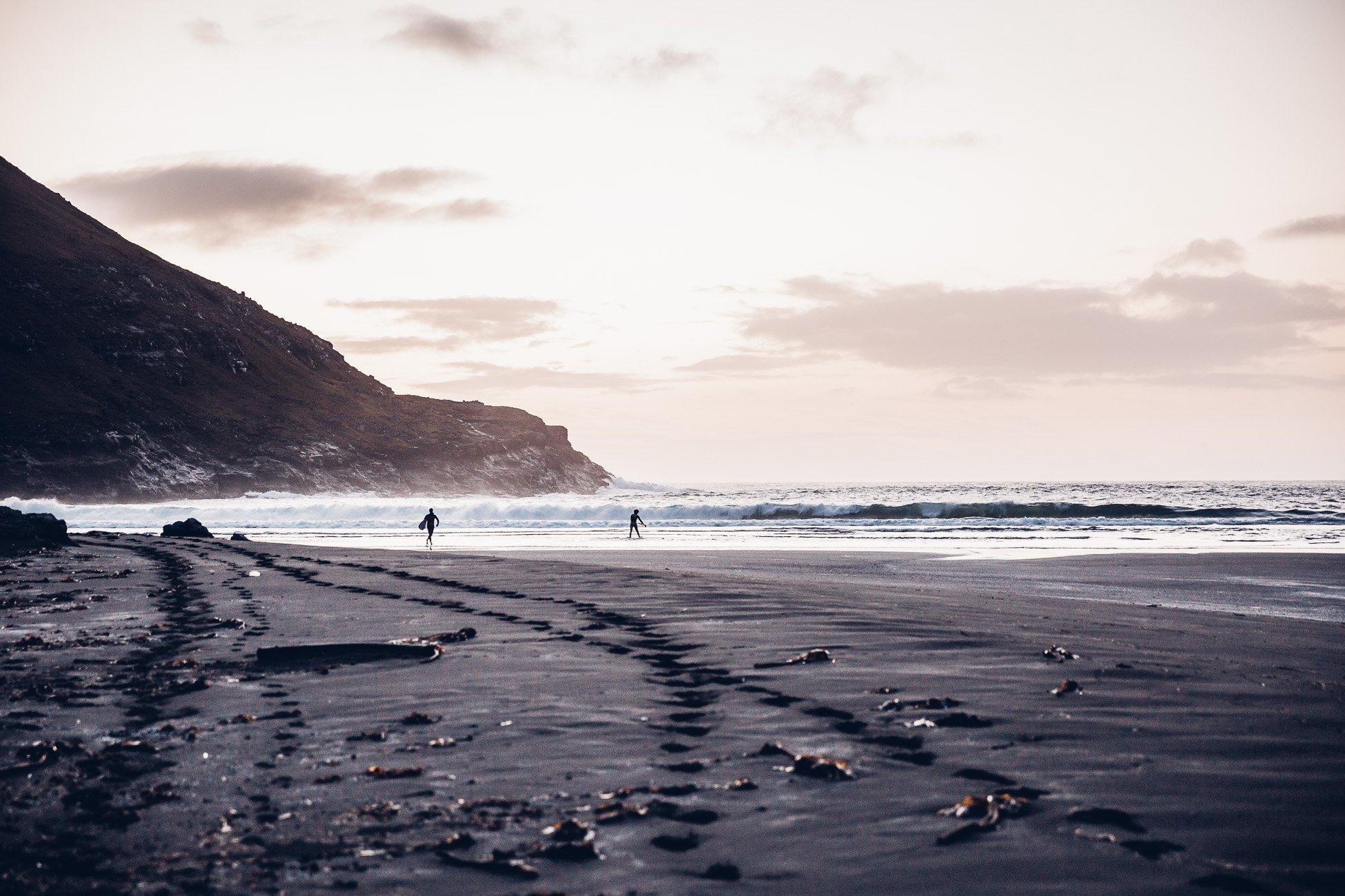 Surfers at Saksun Faroe Islands