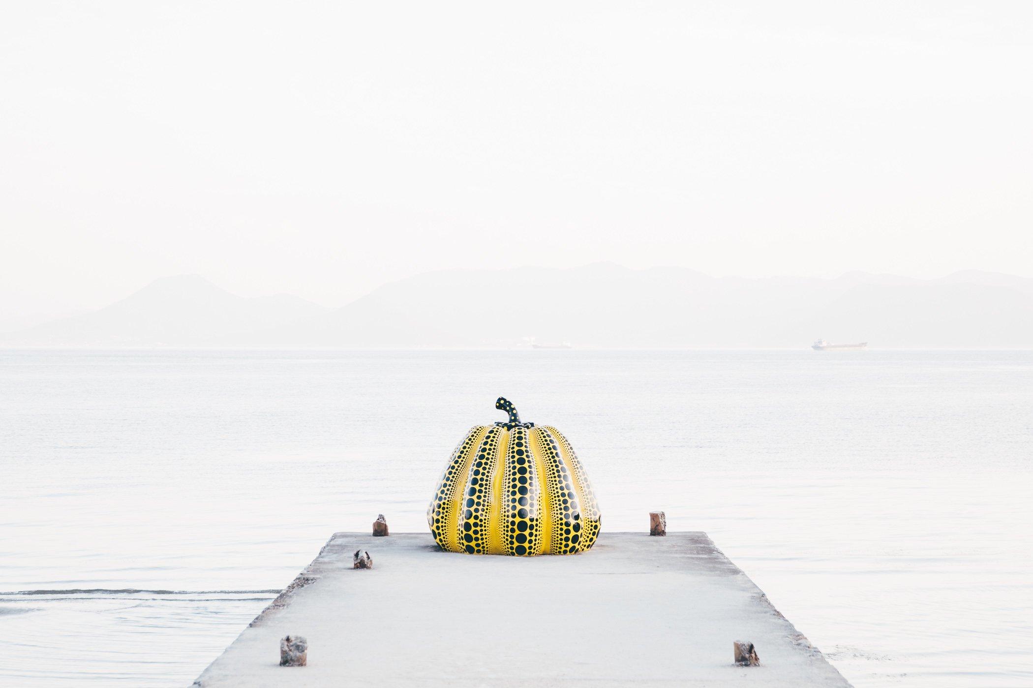 Yayoi Kusuma yellow pumpkin in Naoshima Japan