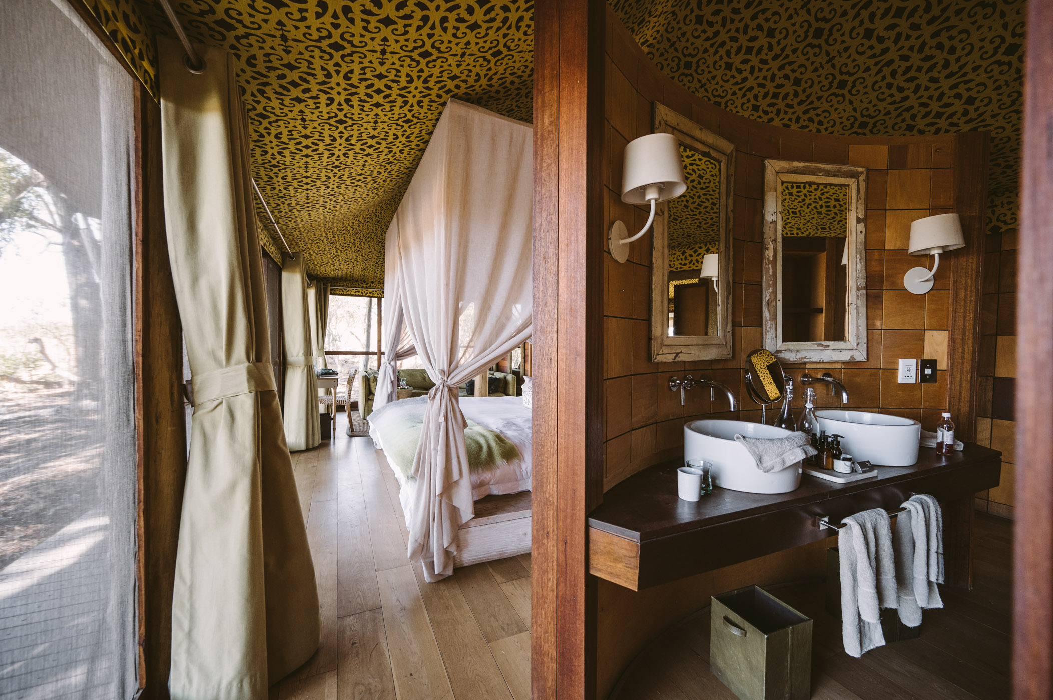 andBeyond Xaranna Okavango Delta Camp bedroom and bathroom