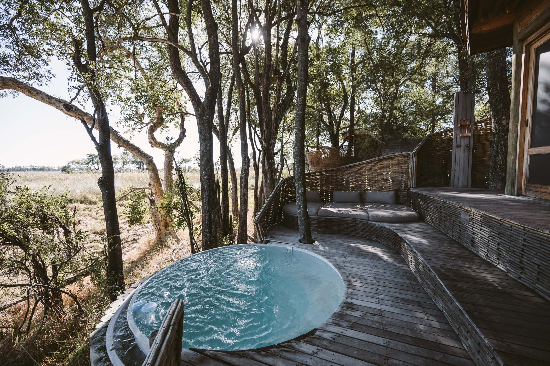 andBeyond Sandibe Okavango Delta Lodge deck and plunge pool