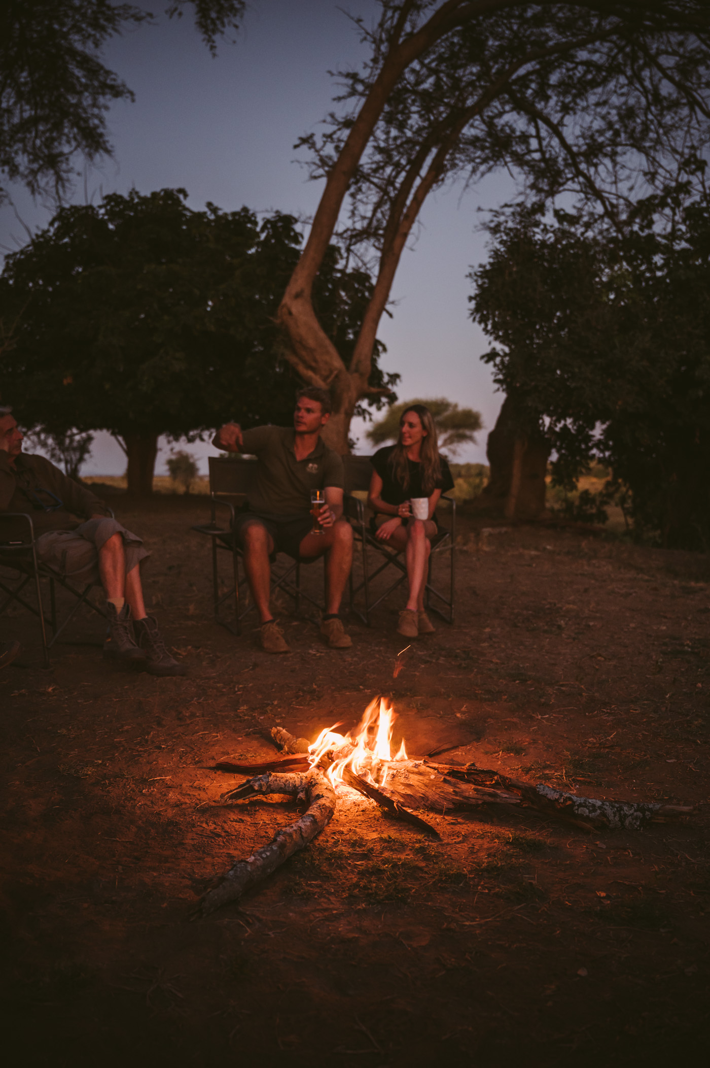 Kyle & Sarah of Tusk & Mane at the fireplace in Lower Zambezi National Park Zambia