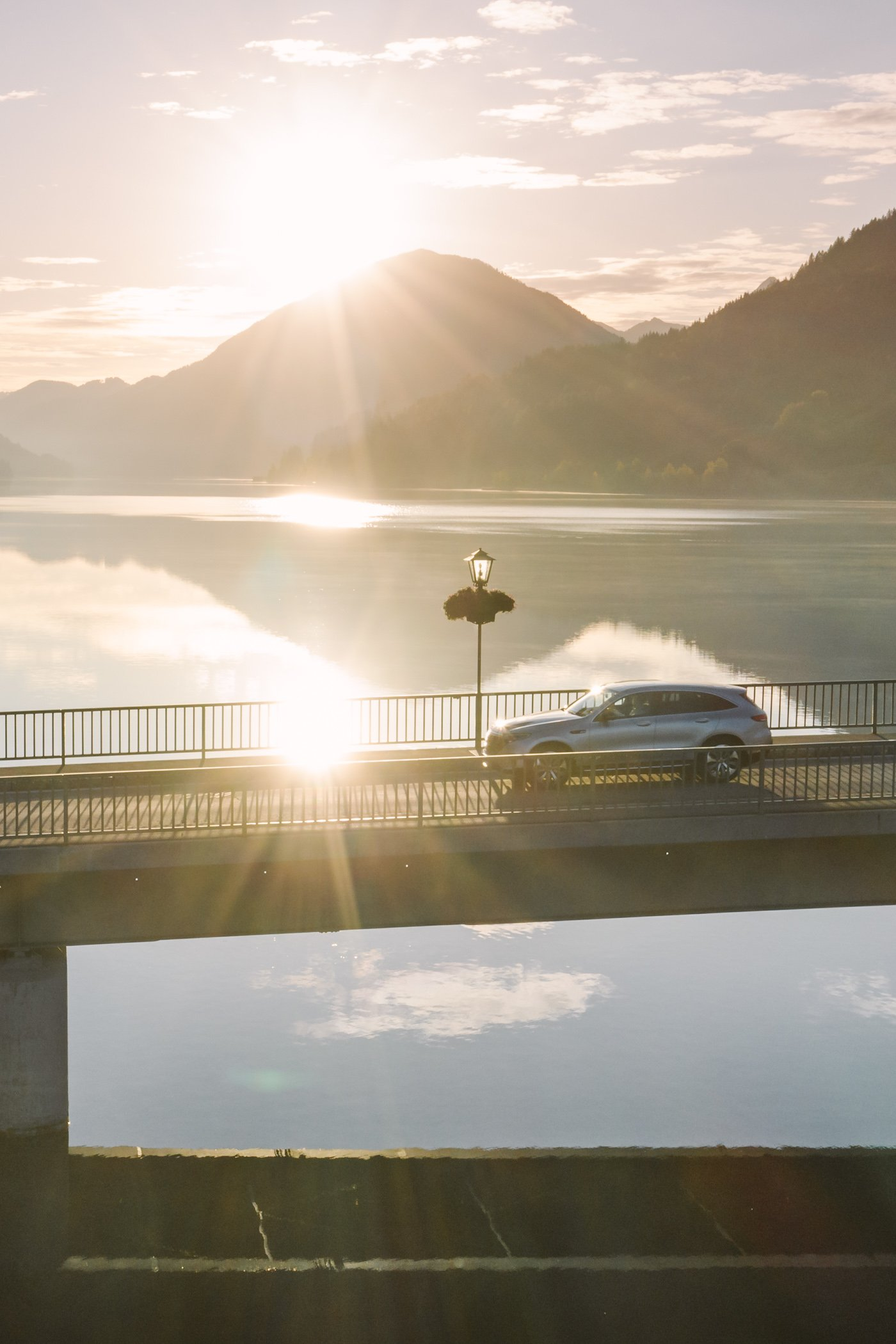 Driving the Mercedes EQC at Lake Weissensee at sunrise, in Carinthia Austria