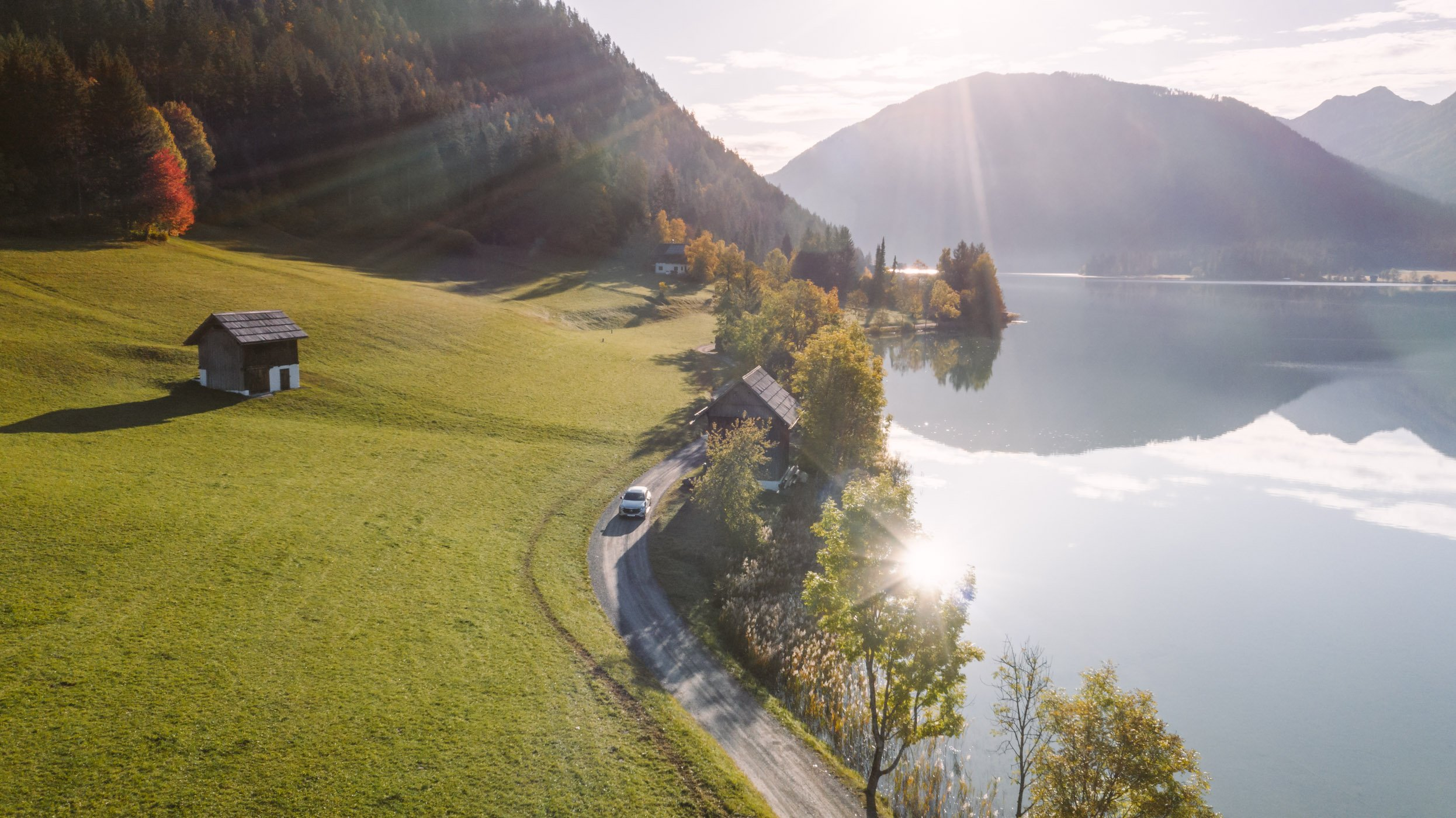 Mercedes EQC at Lake Weissensee at sunrise, in Carinthia Austria