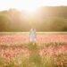 Standing in a poppy field in summer