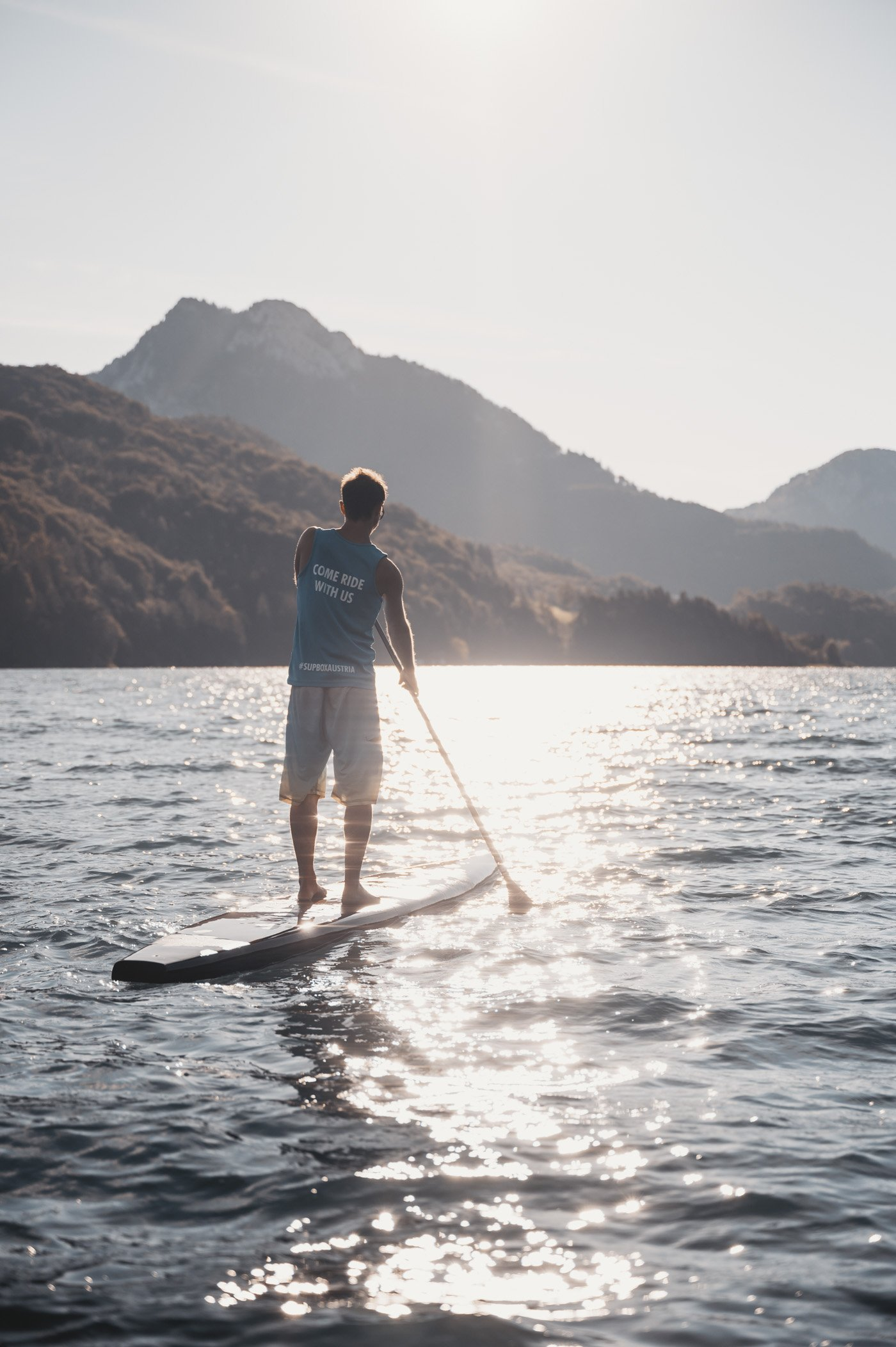 Stand-up paddling at lake Fuschl with SUP Box Austria