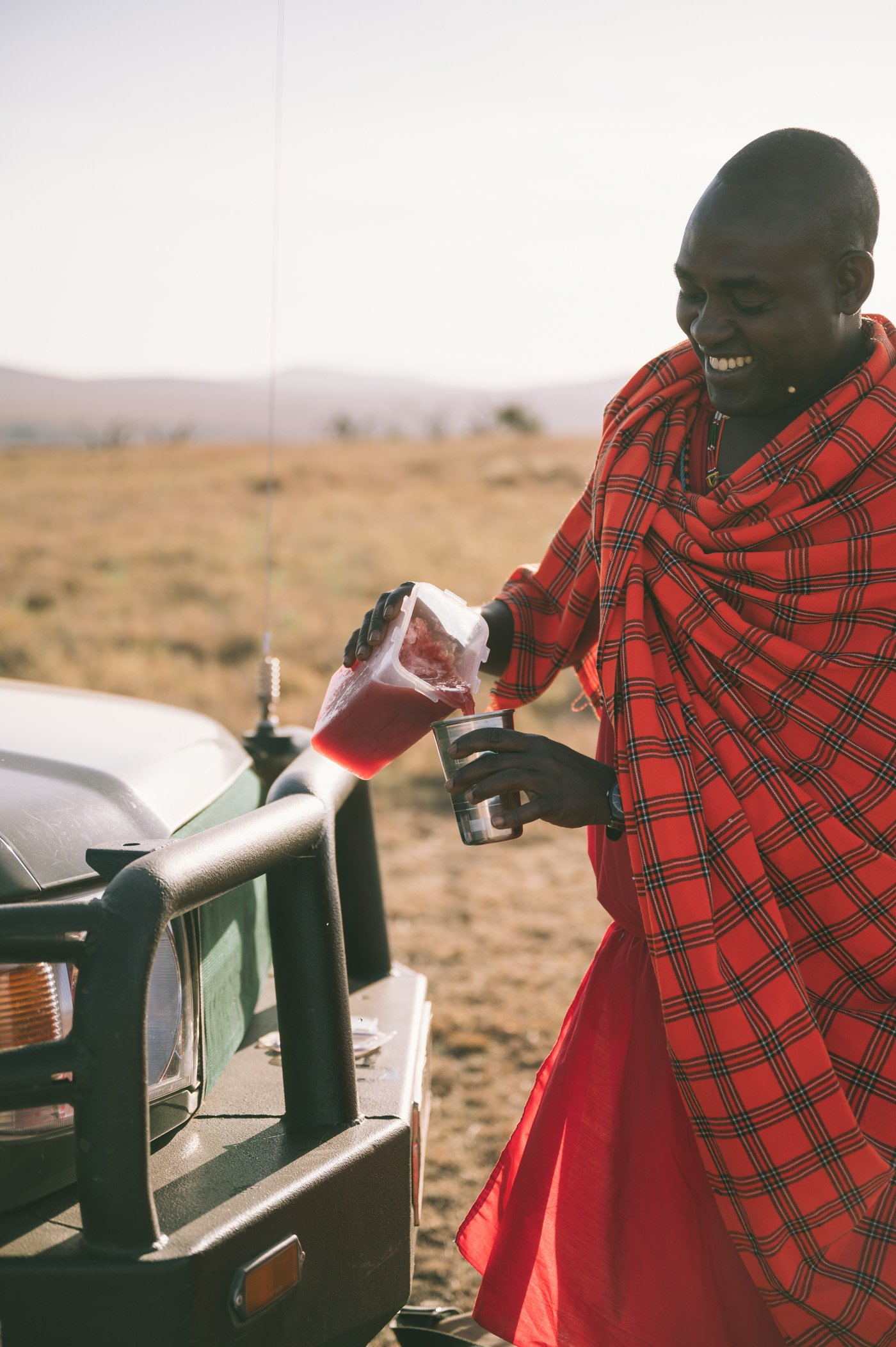 Our guide David serving a tree tomato juice at Lewa Wildlife Conservancy Kenya