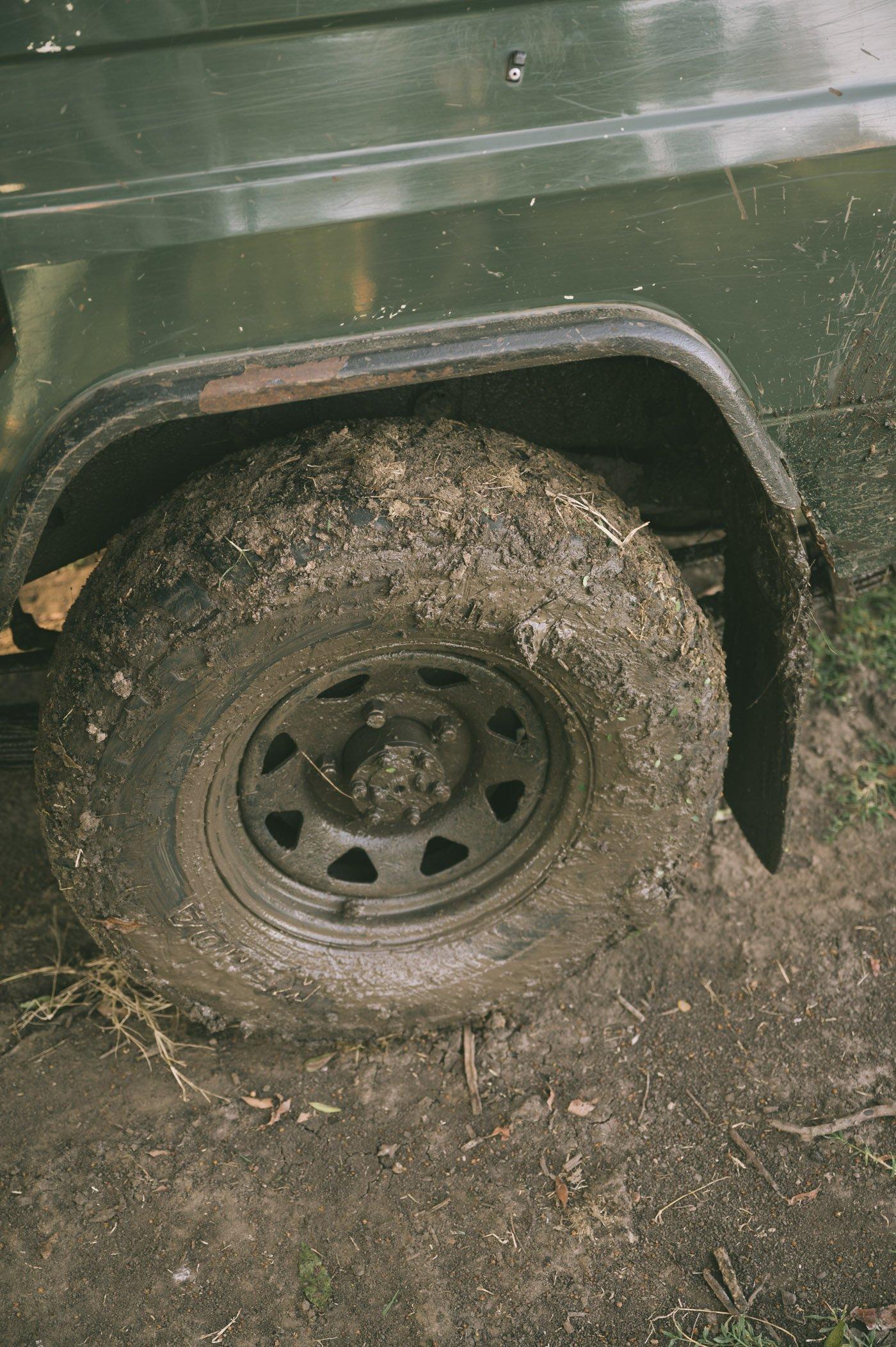 Muddy tyres after being stuck in the Maasai Mara in Kenya