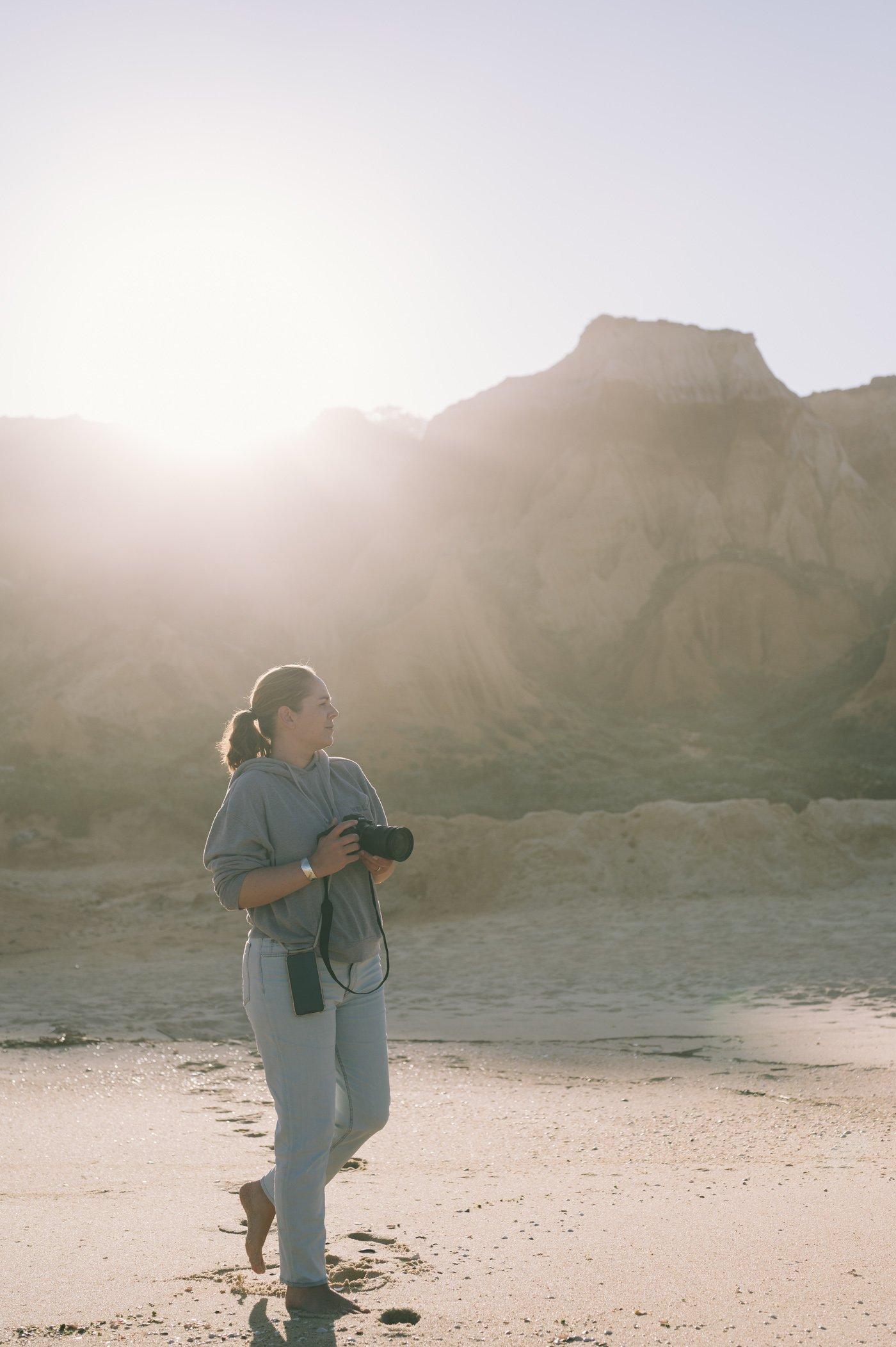 Marion Payr photographing at Praia da Galé - Fontainhas