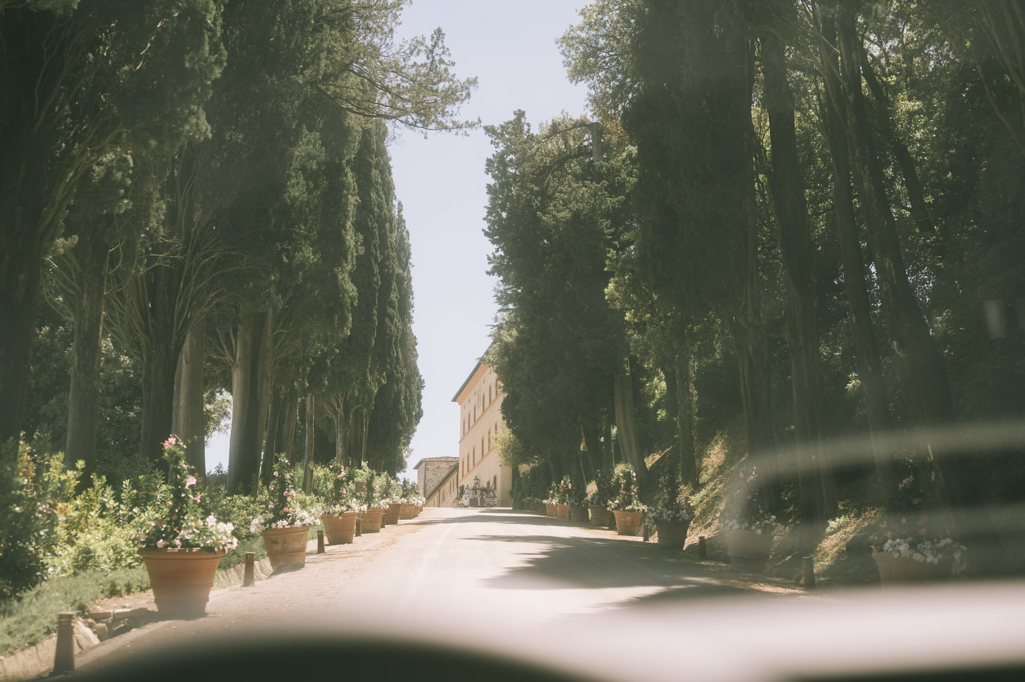 The drive up to Belmond Castello di Casole luxury hotel and estate in Tuscany Italy